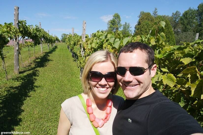 Wineries in Door County – a couple in the vineyard at Simon Creek Vineyard & Winery