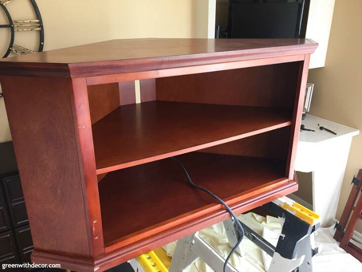 A brown wood TV stand before being painted up on sawhorses