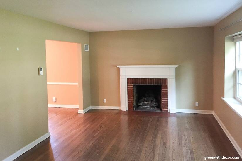 Tan living room with fireplace before built-in bokoshelves