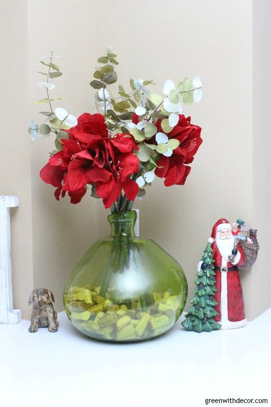 Christmas centerpiece idea with red flowers and eucalyptus