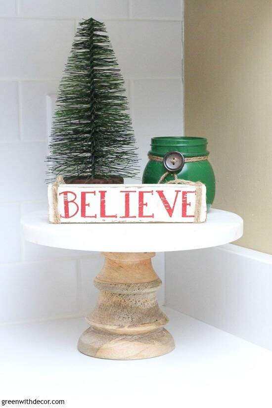 Christmas cake platter with tree, candle and believe sign