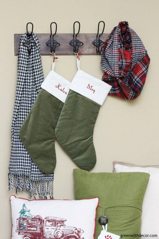 Christmas mudroom with green stockings and wood hooks