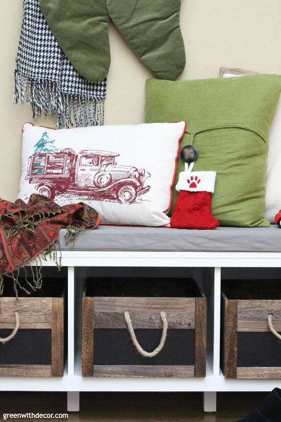 Christmas mudroom with wood and rope crates and holiday pillows