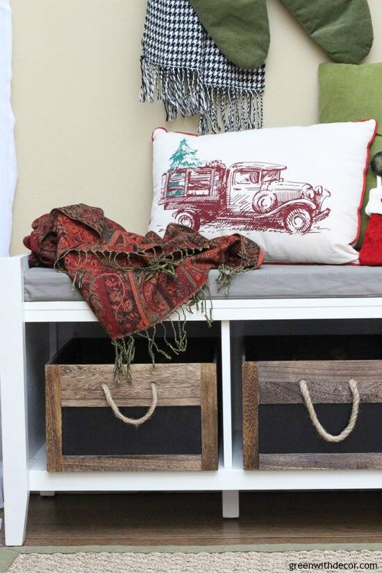 Christmas mudroom with truck holiday pillow and red pashmina