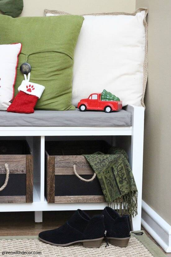 Christmas mudroom with rustic crates and holiday pillows