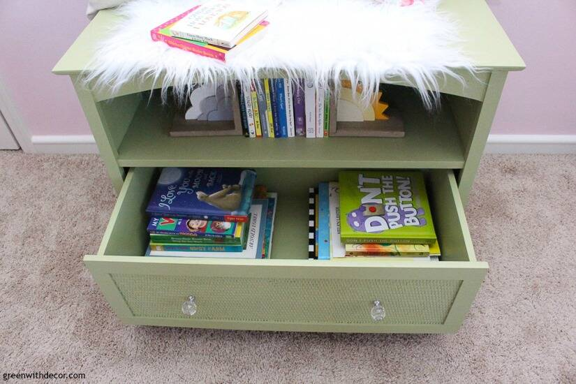 A green TV stand turned into book storage