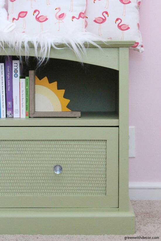 A TV stand turned book storage for a nursery