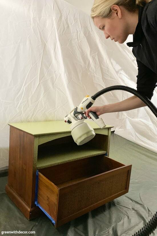 Using a paint sprayer to paint an old TV stand