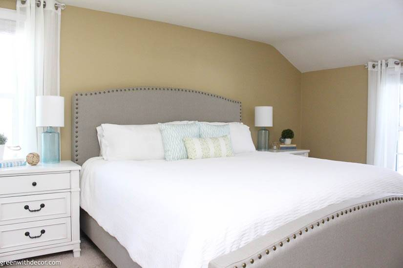 Coastal bedroom with upholstered headboard