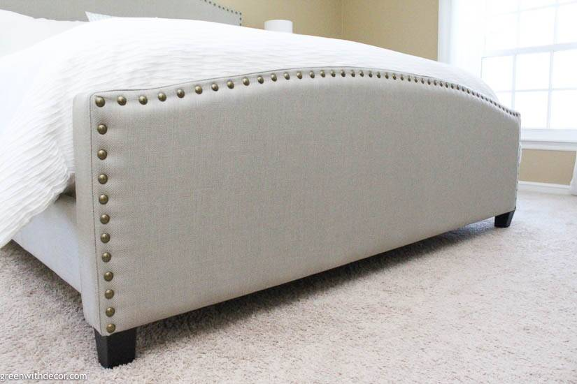 Gray upholstered footboard in coastal bedroom