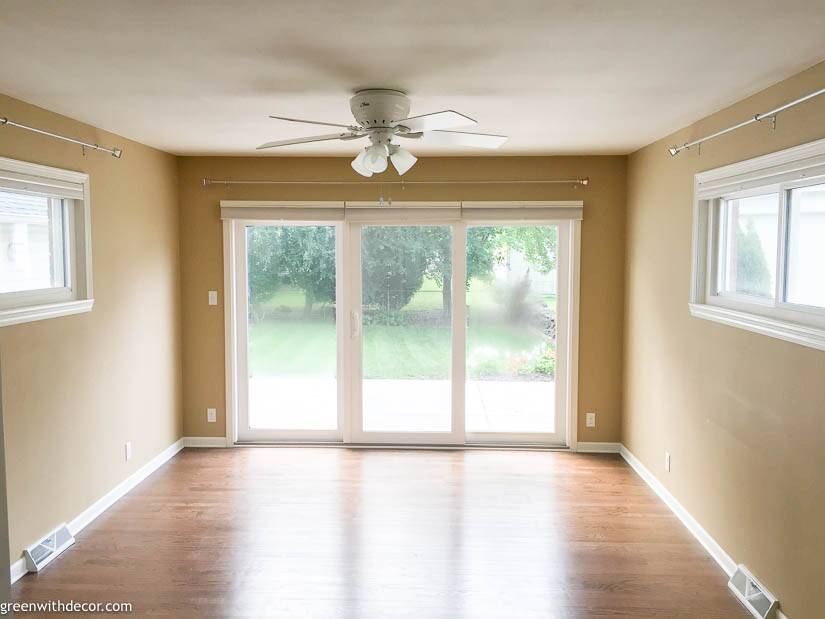 Tan room with white trim, hardwood floors and patio doors