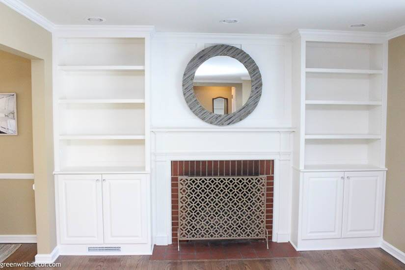 White built-in bookshelves around a fireplace