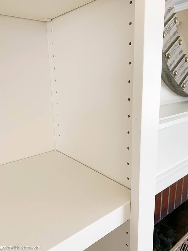 Adjustable shelving on white built-in bookshelves