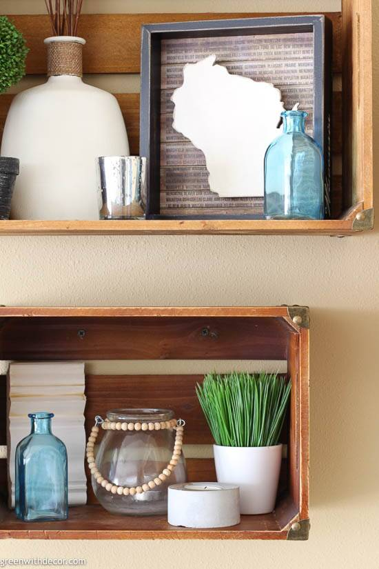 Two wood crate shelves with aqua, white and green coastal decor