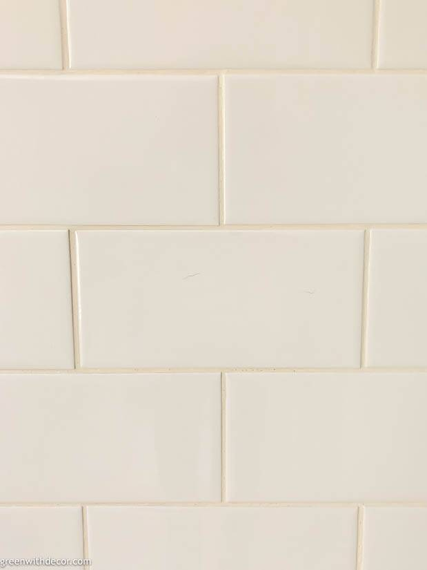 Clean white subway tile with white grout