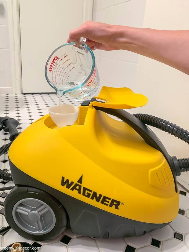 Pouring water into a Wagner steam cleaner