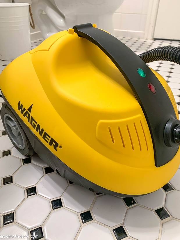 A Wagner steam cleaner sitting on a black and white tile floor