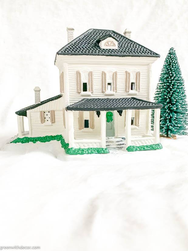 White painted Christmas village house with black roof and tan shutters
