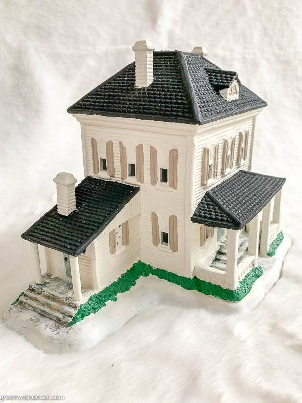 White painted Christmas village house with tan shutters and a black roof