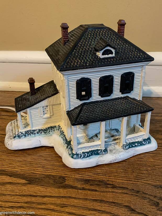 White painted Christmas village piece with black shutters