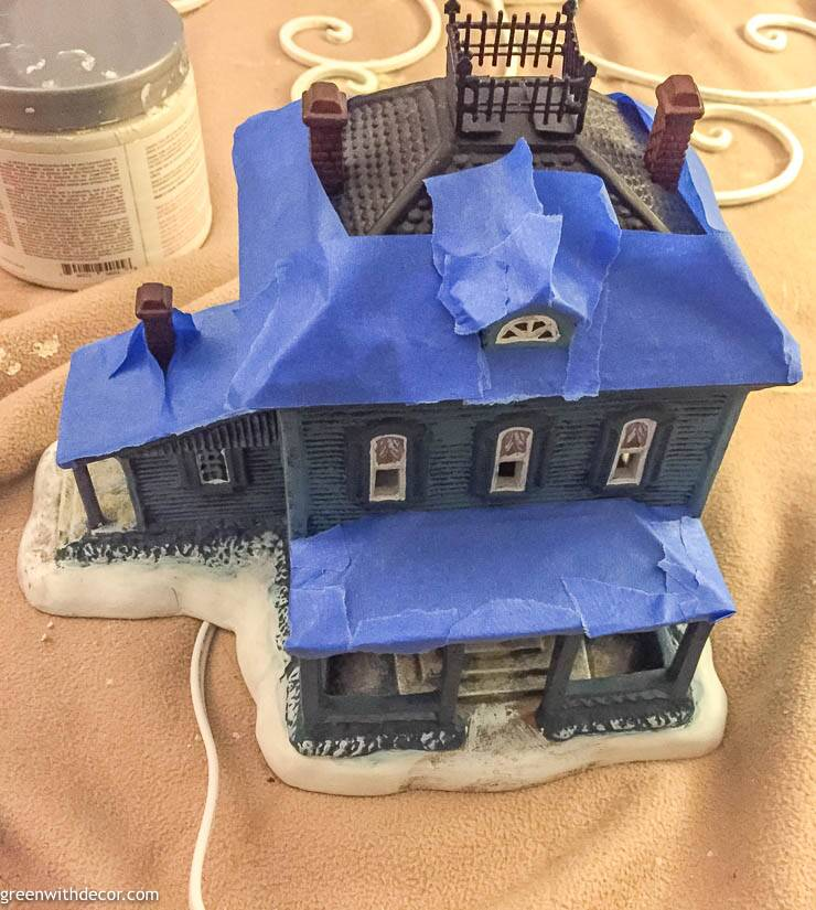 Blue Christmas village house with painters tape