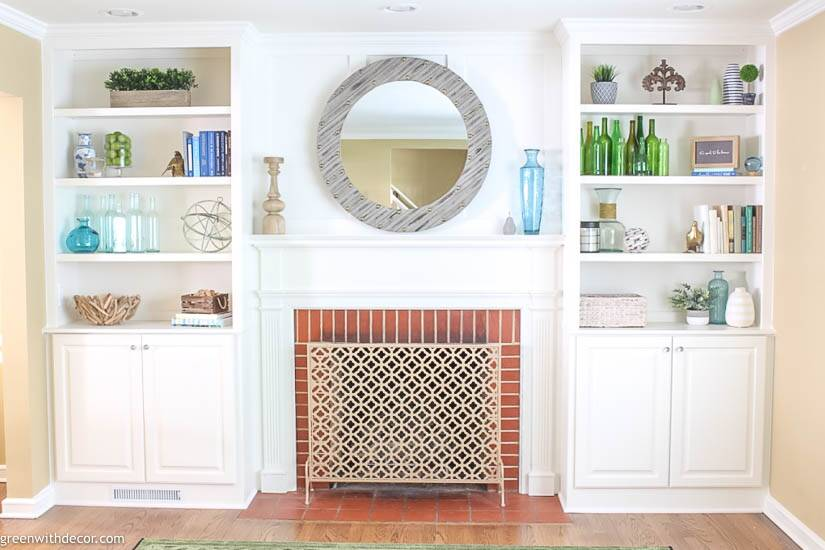 White decorated bookshelves with coastal pieces