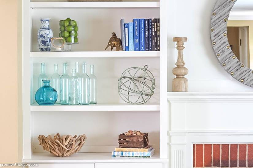 Bookshelf decorating ideas: wine bottles, books, a driftwood bowl and more!