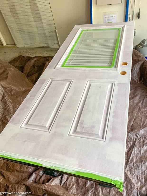 Painting an exterior door with a coat of primer