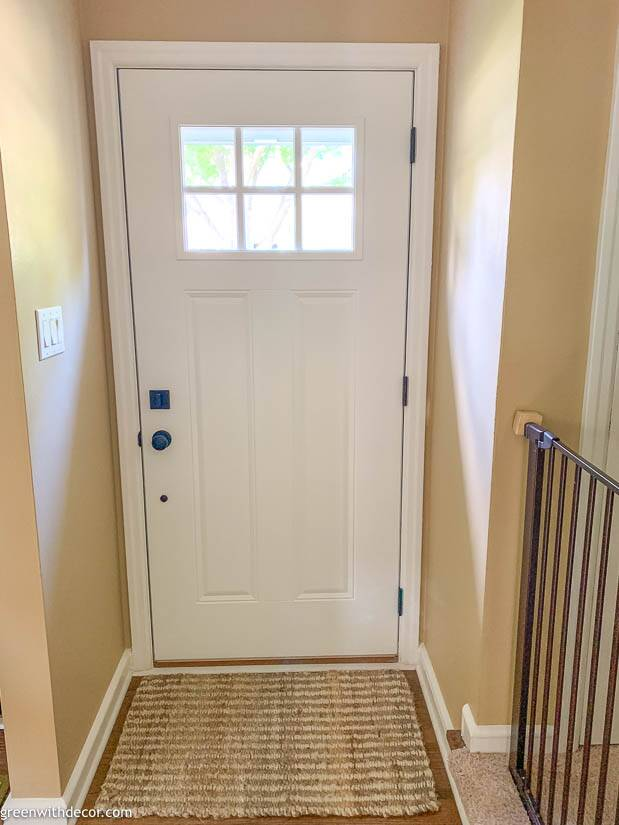 Painting an exterior door with white paint and trim