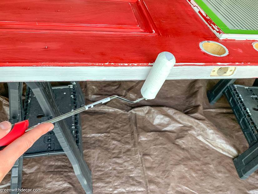 Painting an exterior door, painting the edge with a roller