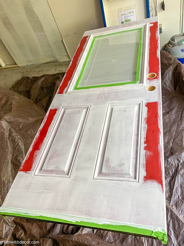 Painting an exterior door, sitting on sawhorses