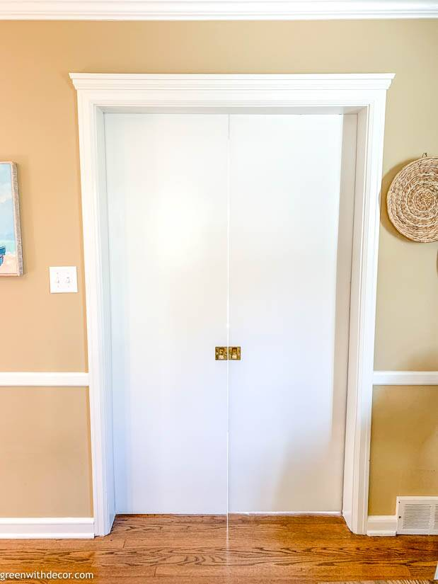 White pocket doors painted white near coastal artwork