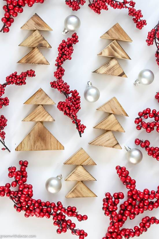Burned wood DIY Christmas trees with red berries and silver ornaments