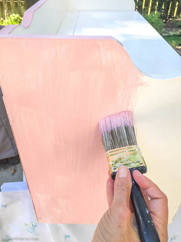 Painting a bench with pink paint