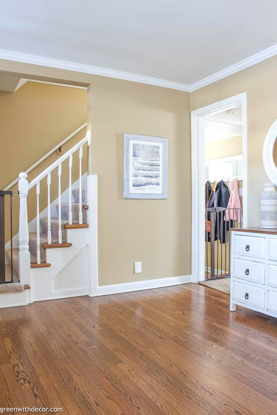 Small coastal foyer with stairs artwork