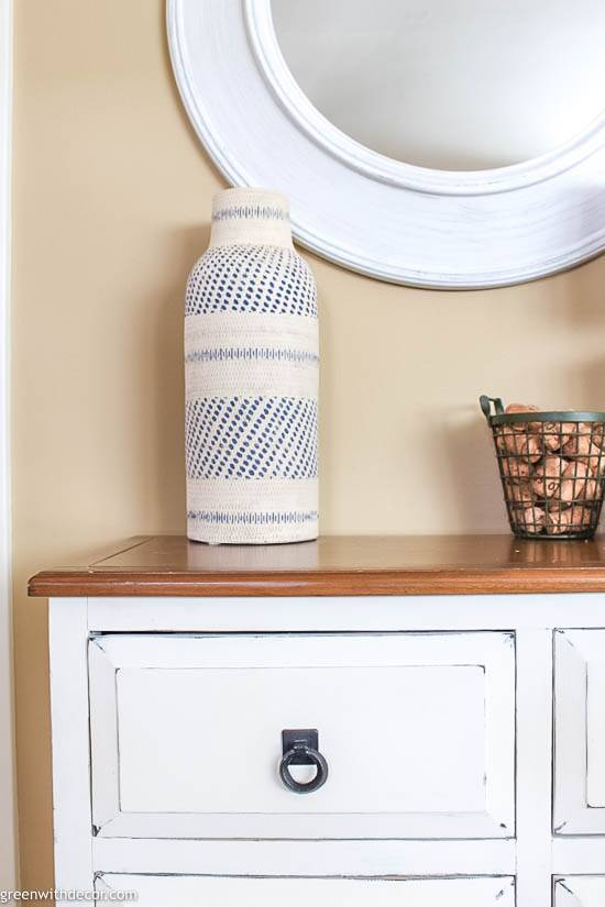 Small coastal foyer with white dresser and boho vase