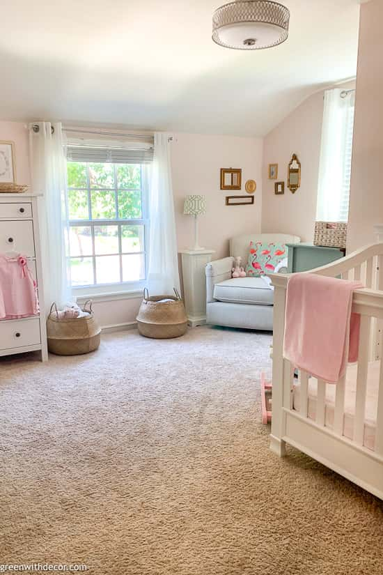 Girl's pink nursery with tan carpet
