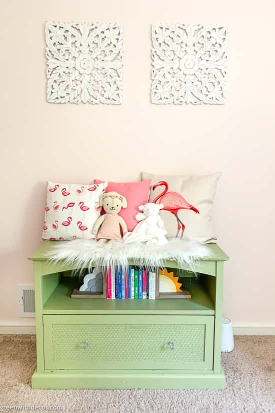 Green reading bench in pink girl's nursery