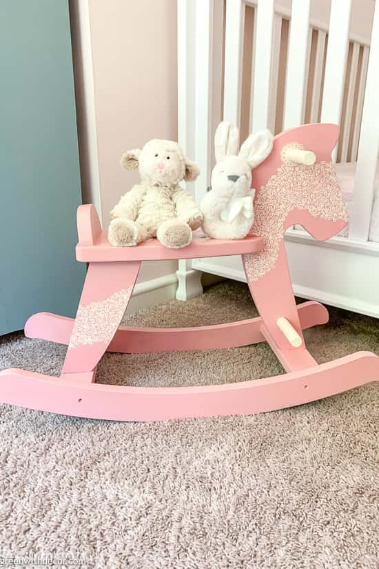 Pink rocking horse in pink girl's nursery
