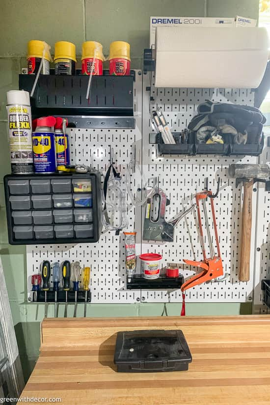 Screw and nail tool organizer on a white pegboard