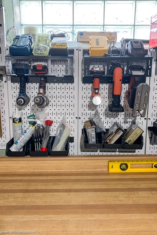 Drill holders on white pegboard
