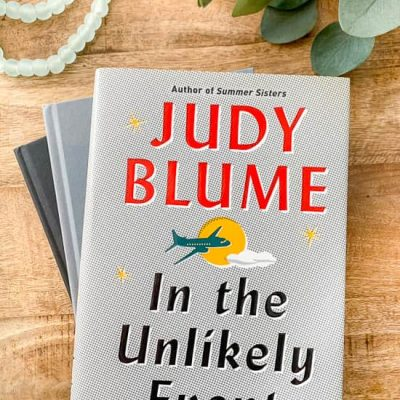 In the Unlikely Event by Judy Blume on wood coffee table