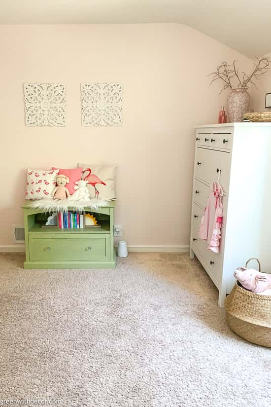 Reading bench in pink girl's nursery